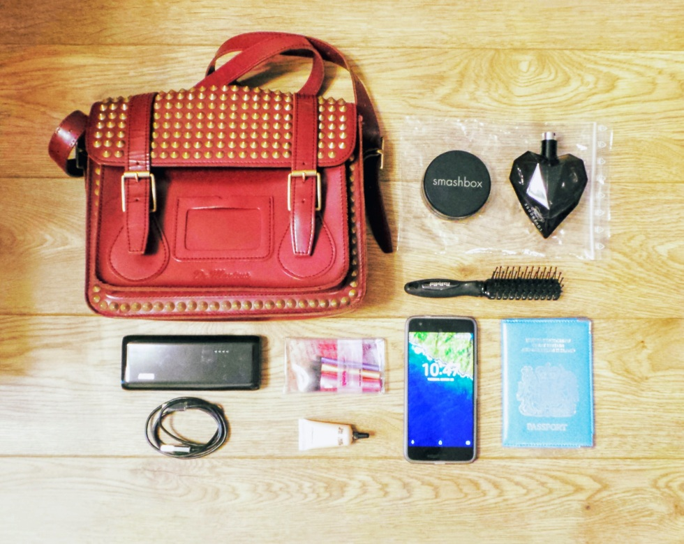 Satchel with key components for travelling abroad for 1 day